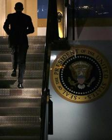 President Obama headed up a stairway to Air Force One as he departed from Logan International Airport on Wednesday.